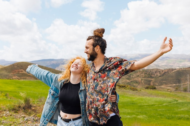 Man and woman open arms in nature