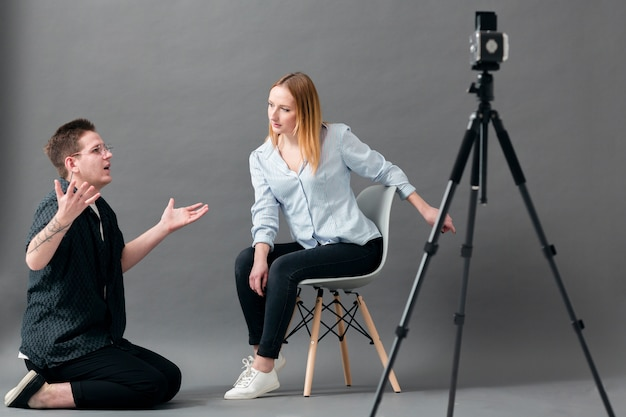 Man and woman posing in a studio