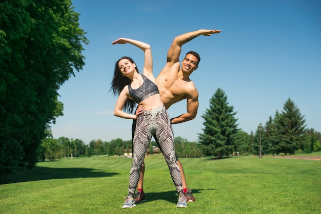 Man and woman practicing yoga outdoor