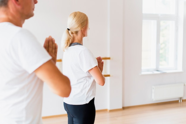 Man and woman practicing yoga together