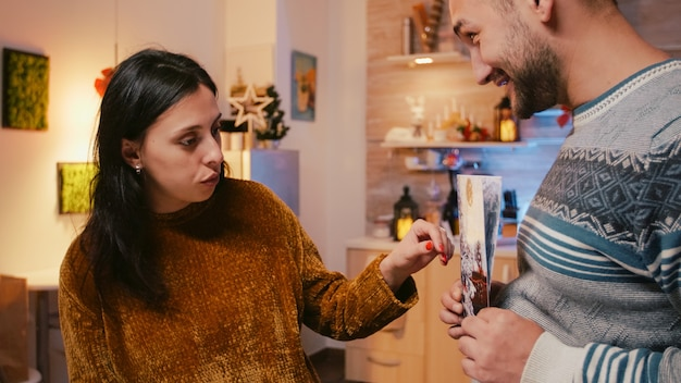 Man and woman preparing christmas card for holiday festivity