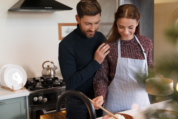 Man and woman preparing the christmas dinner together