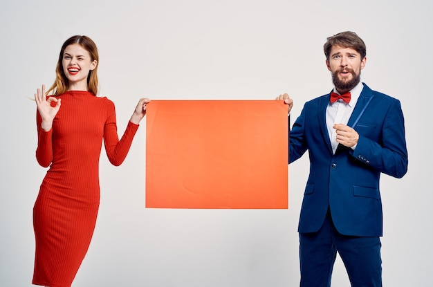 Man and woman pull at each other red mockup poster advertisement sale