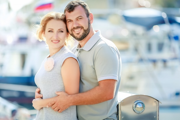 Man and woman on romantic trip cuddle together