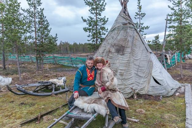 Man and woman, sami in national dress, sami village on the kola peninsula, russia.