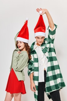 Man and woman santa hat holiday friendship