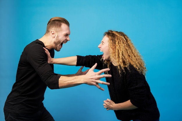 Man and woman screaming at each other, quarreling and fighting.