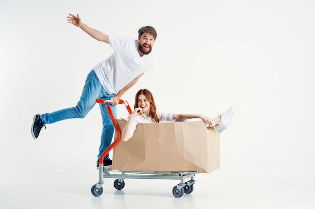 Man and woman shipping transport in a box isolated background