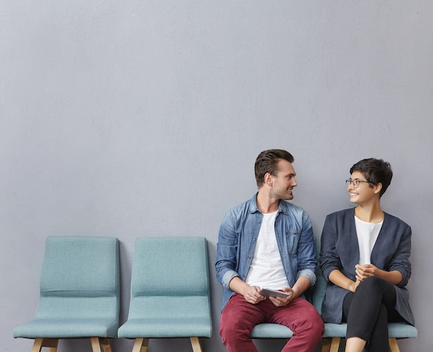 Man and woman sitting in waiting room