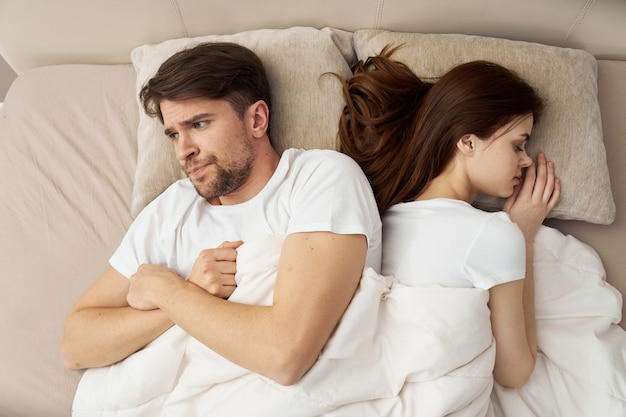 Man and woman sleep in bed, phone, cheating, love relationship