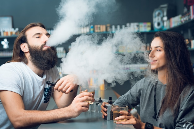 Man and woman smoke together in store.