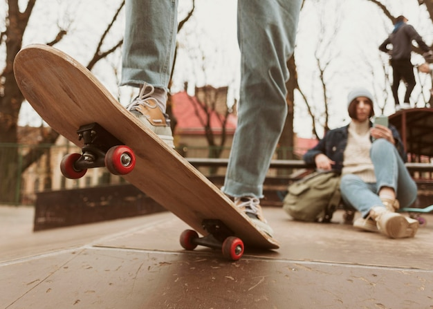 Man and woman spending time together outdoors while skateboarding