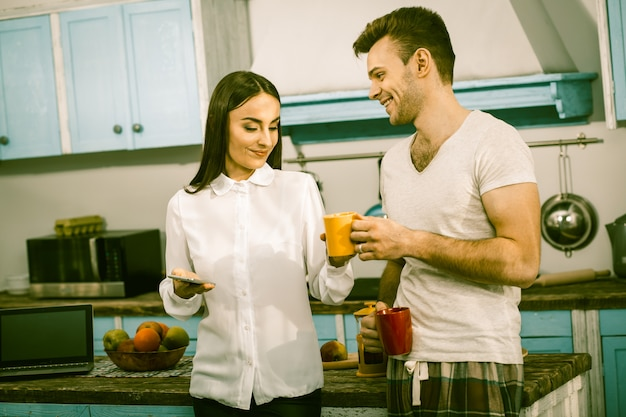 Man and woman spends time together in home kitchen