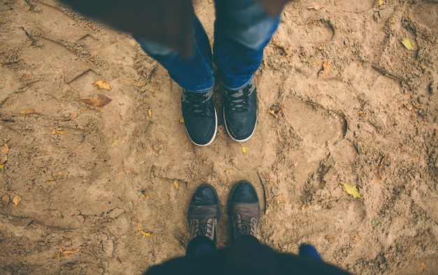 Man and woman stand opposite each other.