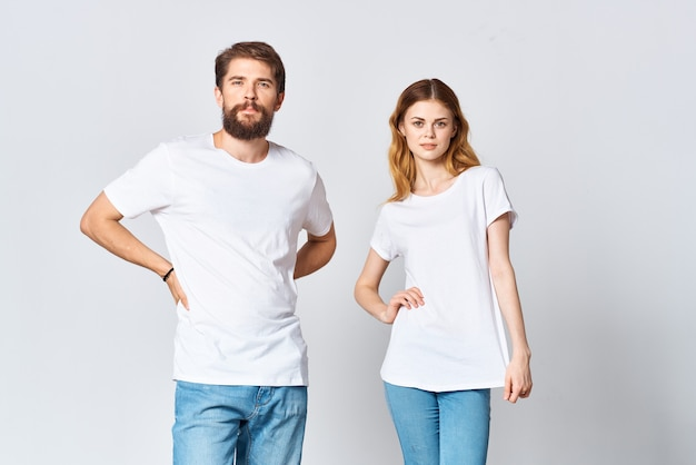 Man and woman stand side by side in white tshirts copy space mockup design