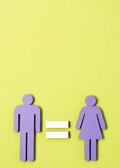 Man and woman standing with equal sign between them copy space