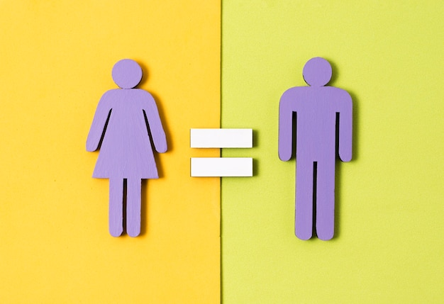 Man and woman standing  with equal sign between them