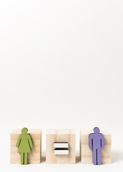 Man and woman standing on wooden blocks copy space