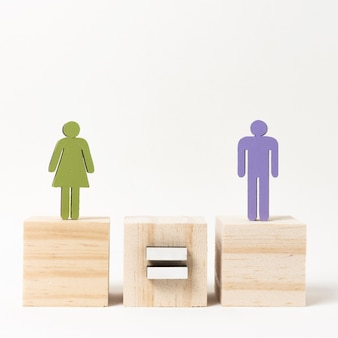 Man and woman standing on wooden blocks