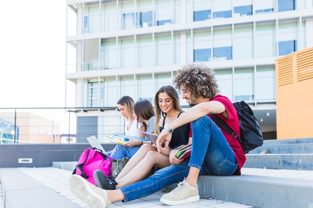 Man and woman studying near friends