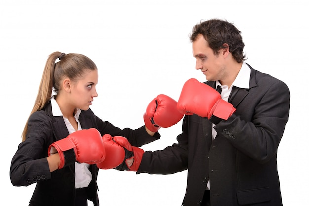 Man and woman in suits are boxing together.