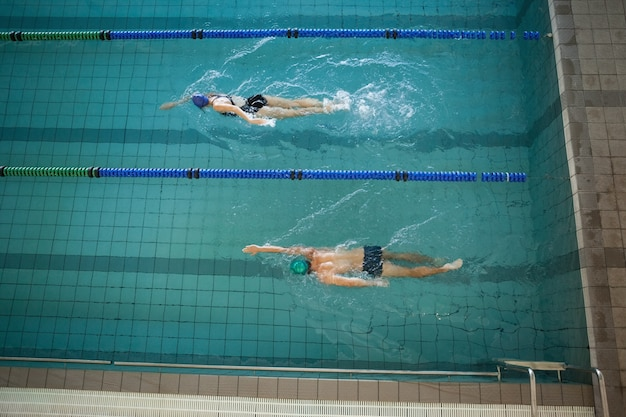 Man and woman swimming in the pool