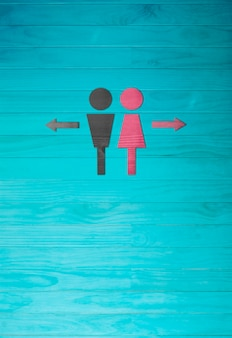 The man and woman symbol,toilet sign on blue wooden wall background.