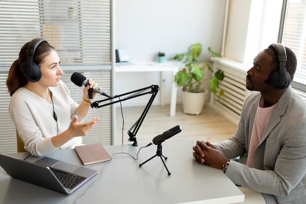 Man and woman talking in a podcast