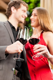 Man and woman tasting wine in restaurant