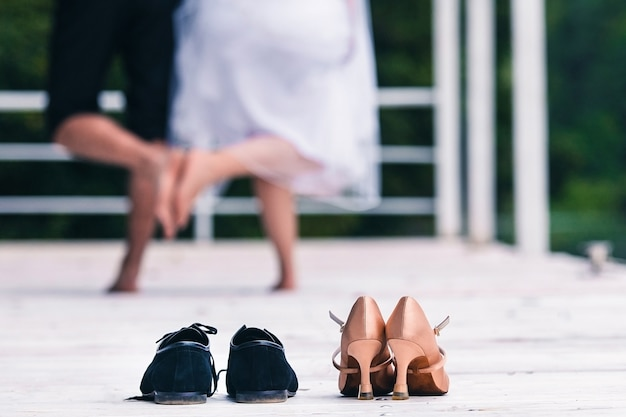 Man and woman touch their feet to each other without shoes in the room