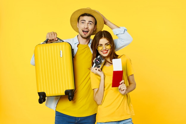 Man and woman traveler with a suitcase, joy, passport