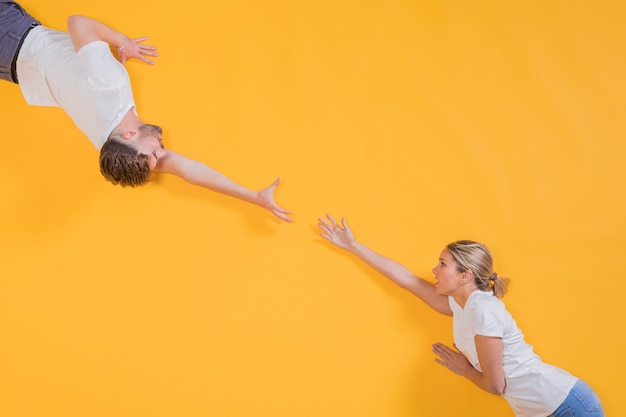 Man and woman trying to reach to eachother