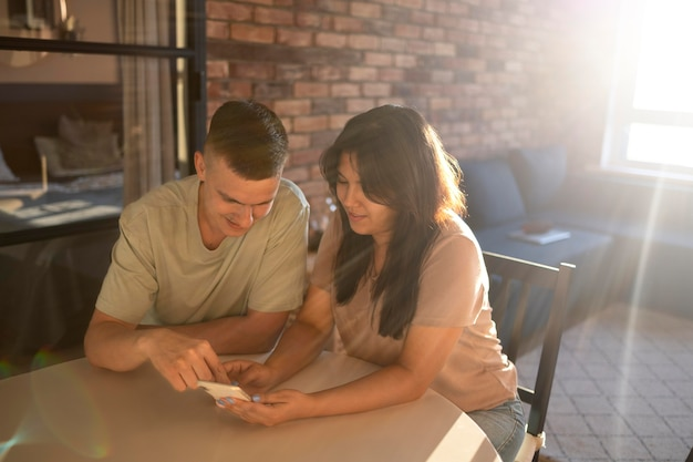 Man and woman using smartphone for online shopping