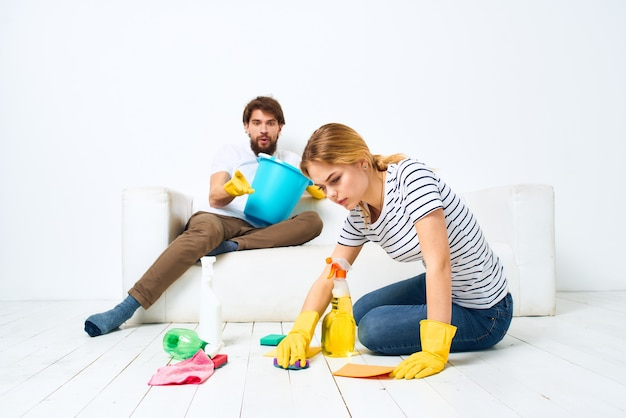 Man and woman washing supplies cleaning housework