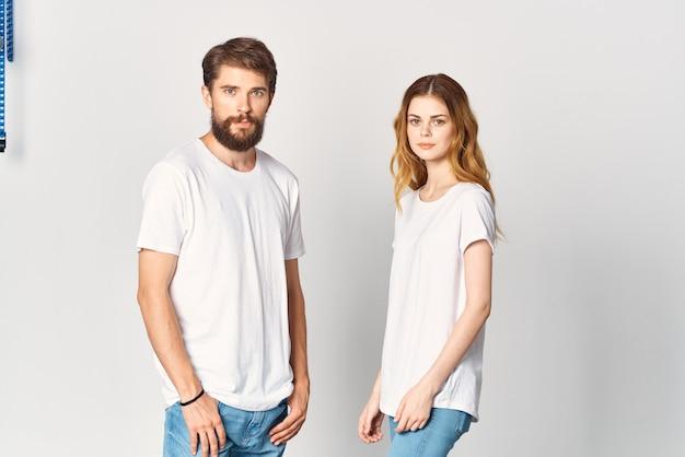 Man and woman in white tshirts socializing posing fashion design