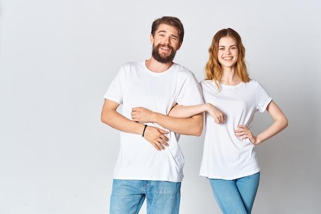 Man and woman in white tshirts studio fashion posing