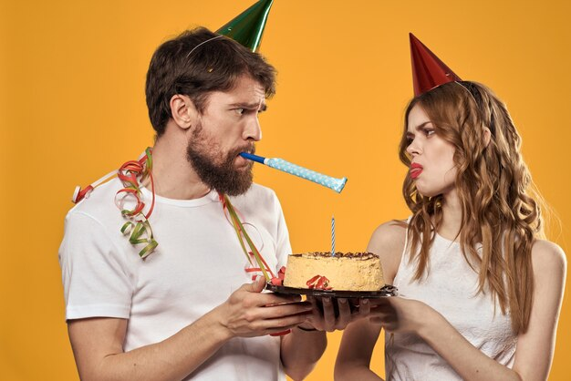 A man and a woman with a cake and a candle