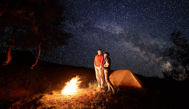 Man and woman with campfire