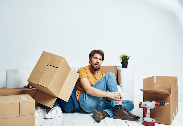 Man and woman with empty boxes moving to an apartment
