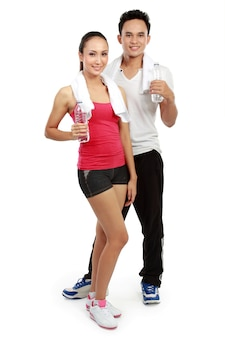 Man and woman with water after workout