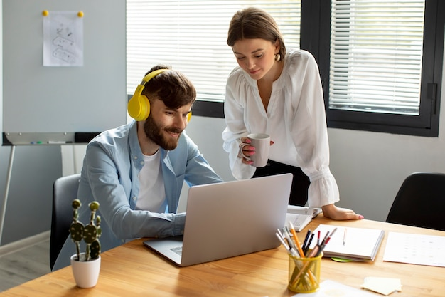 Man and woman working together in a startup company