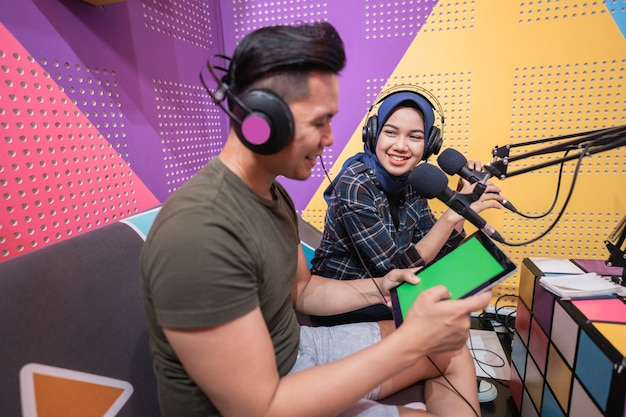 Man and women discussing on live streaming during podcast