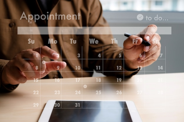 Man work business writing working and schedule calendar busy schedule tasks and appointments in weekly planner schedule