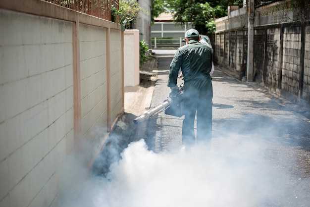 Man work spray fogging, get rid of mosquitoes to stop the spread of dengue fever
