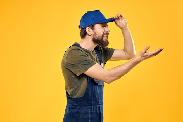 Man in work uniform rendering service forklift work lifestyle yellow space.