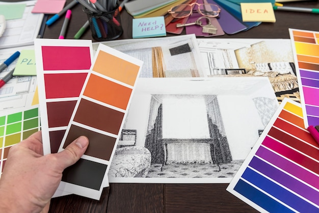Man work with color palette and house apartament sketch for creative design home. architect renovation plan