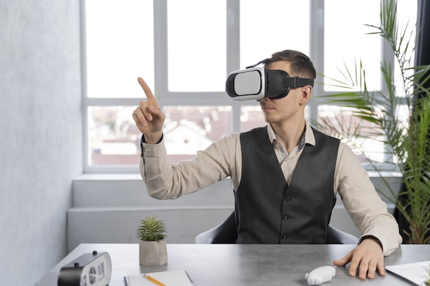 Man at work with vr glasses