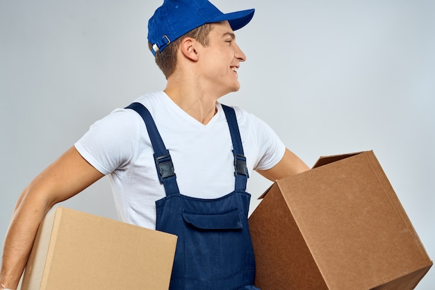 Man worker with box in hands delivery loading service packing service