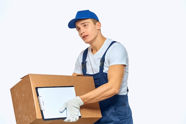 Man worker with box in hands delivery loading service work light space.