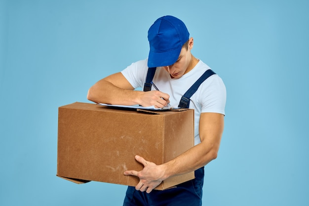 Man worker with cardboard box delivery loader lifestyle blue